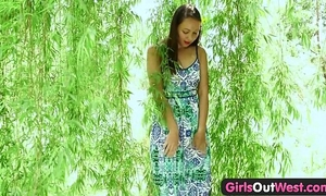 Girls out west - exotic dilettante chick plays with glass toy